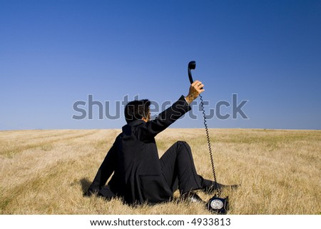 a businessman trying to listen the mother nature - stock photo