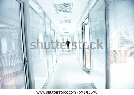 A businessman walking in the office corridor