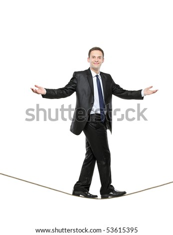 A businessman walking on a high tightrope isolated on white background