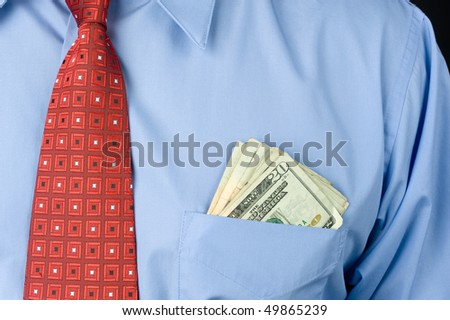 A businessman wearing a shirt and necktie with cash in his front pocket.