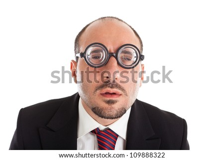 A businessman wearing thick, circle glasses