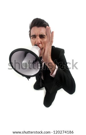 A businessman with a loudhailer. - stock photo