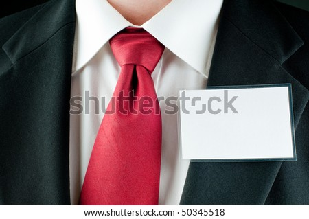 A businessman with a tie with a blank tag - stock photo
