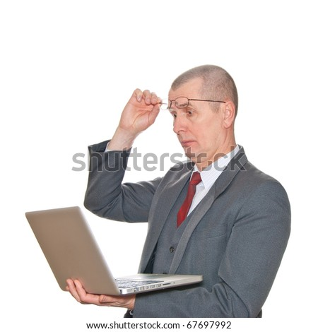 A businessman with glasses and laptop isolated on white. - stock photo