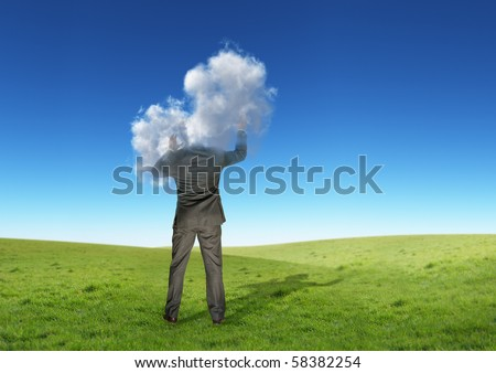 A businessman with his head in the clouds. - stock photo