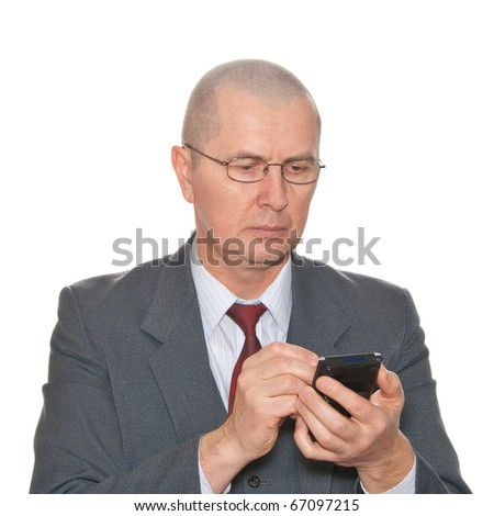 A businessman with his pda isolated on white. - stock photo