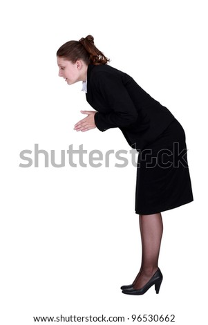 A businesswoman about to dive. - stock photo