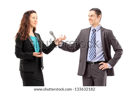 A businesswoman and male reporter having an interview, isolated on white background - stock photo