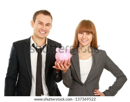 A businesswoman and man holding a piggy bank , isolated on white background - stock photo