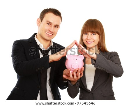 A businesswoman and man holding a piggy bank isolated on white background - stock photo