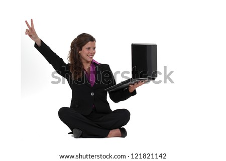 A businesswoman doing the V of victory. - stock photo