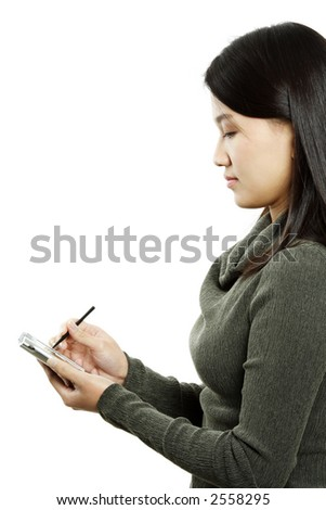 A businesswoman holding a PDA and a stylus - stock photo