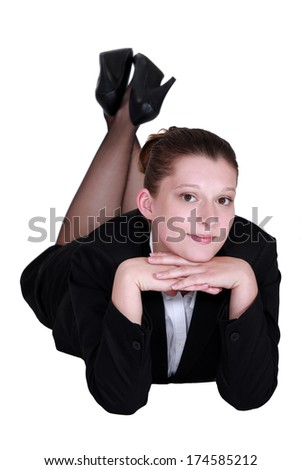 A businesswoman laying on the floor. - stock photo