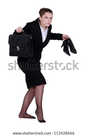 A businesswoman leaving quietly.