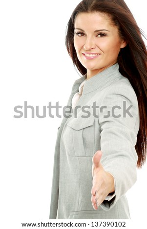 A businesswoman offering a handshake, isolated on white background - stock photo