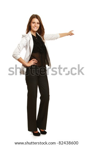 A businesswoman pointing with her finger, full-length portrait, isolated on white - stock photo