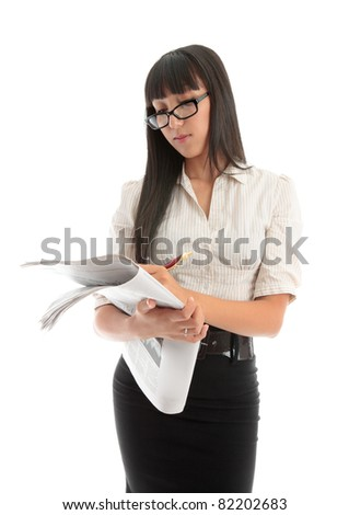 A businesswoman reading the financial newspaper or looking at the careers section