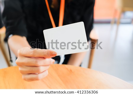 a businesswoman show name card in her hand - stock photo