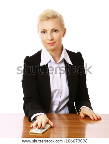 A businesswoman sitting on the desk and giving money, isolated on white background - stock photo