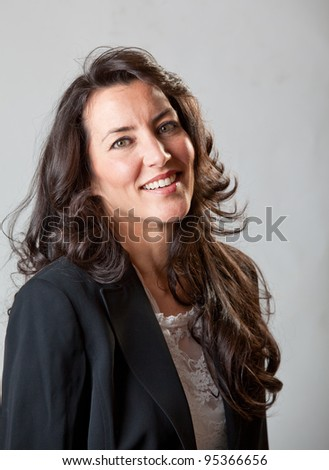 A businesswoman smiling at the camera - stock photo