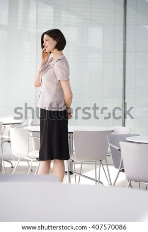 A businesswoman using a mobile phone - stock photo