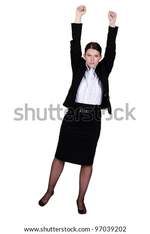 A businesswoman with her two fists up. - stock photo