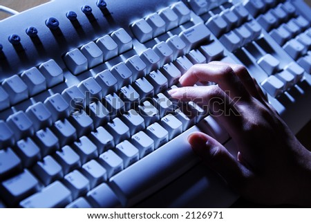 A businesswoman working and typing on her keyboard - stock photo