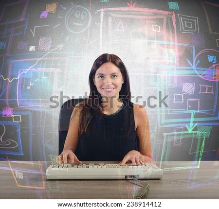 A businesswoman works on her big screen - stock photo