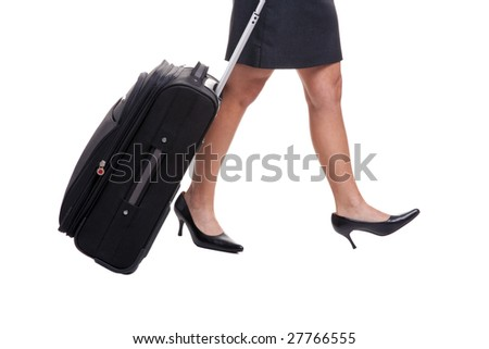 A businesswomans legs in short skirt pulling a suitcase, isolated on white background. - stock photo