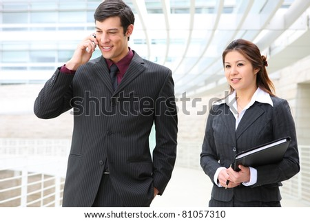 A busy and diverse man and woman business team at the office building - stock photo