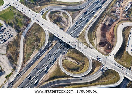 A busy highway with cars traveling in multiple directions. - stock photo