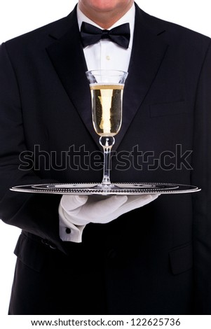 A butler serving a glass of champagne on a silver tray, on a white background. - stock photo
