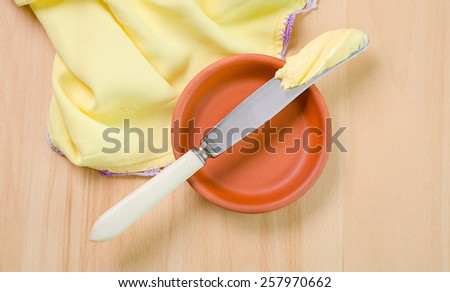 a butter on the knife - stock photo