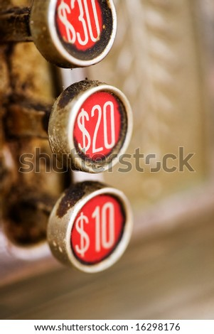 A 20 button on a retro dirty cash register - shallow depth of field - stock photo