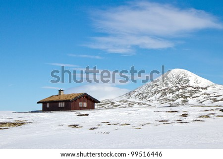 A cabin high up in the mountains in Norway - stock photo