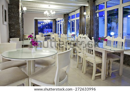 a  cafe - restaurant in a hotel on a island by night - stock photo