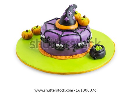 A cake decorated for halloween with spiders, pumpkins and stars. - stock photo