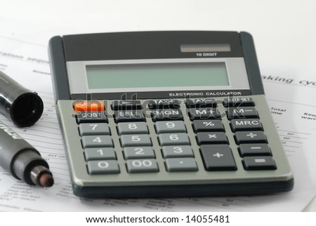 A calculator and marker