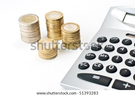A calculator and stacks of euros isolated on a white background