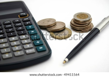 A calculator with pen and coin
