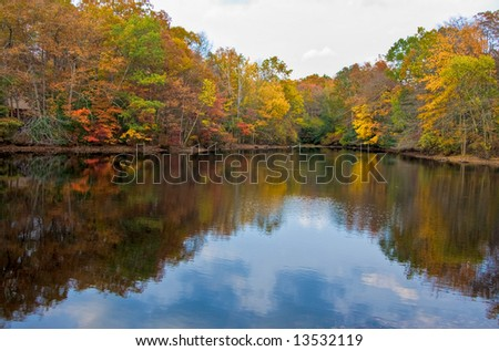 A calm lake and colorful trees in the fall