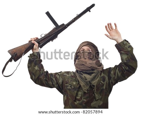 A camouflaged guerrilla warrior screaming for war. - stock photo