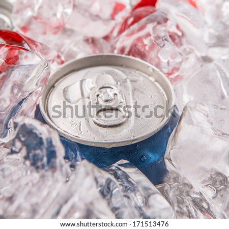 A can of cola drinks with ice cubes - stock photo