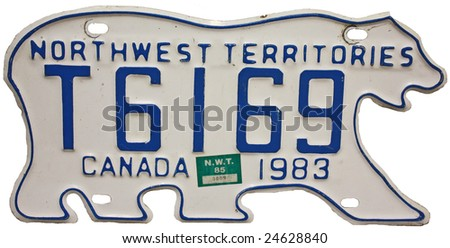 A Canadian license plate shaped like a polar bear isolated on white background - stock photo