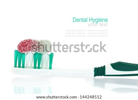 A candy on a tooth brush - symbol for teeth hygiene - stock photo