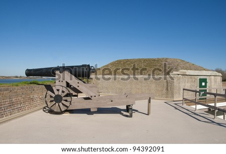 A cannon and the magazine at Fort Jackson on the Savannah River in Georgia. - stock photo