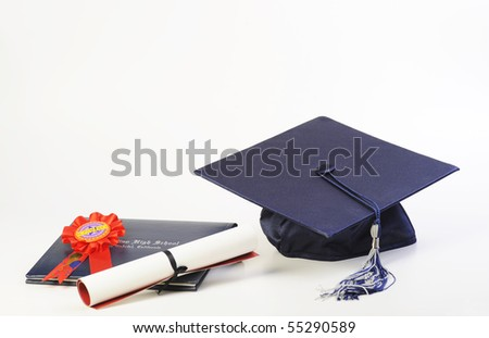 A cap and diploma isolated on white
