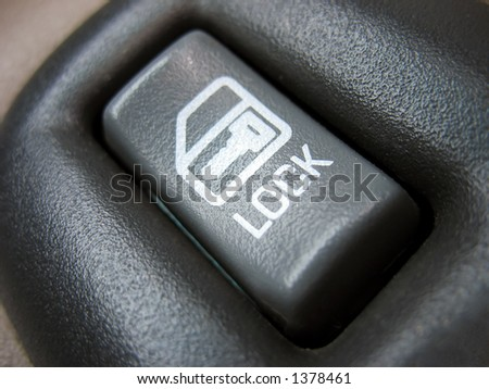 a car door lock button - macro - stock photo