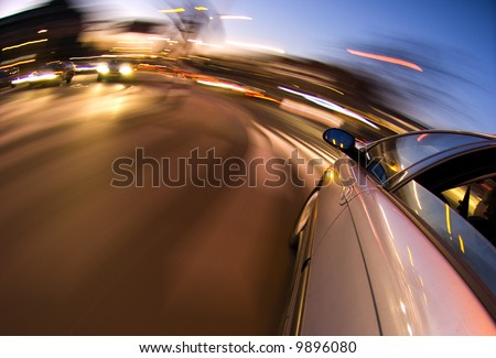 A car driving in the busy downtown streets, with taking a right turn - stock photo