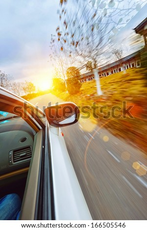 A car driving on a motorway at high speeds, - stock photo